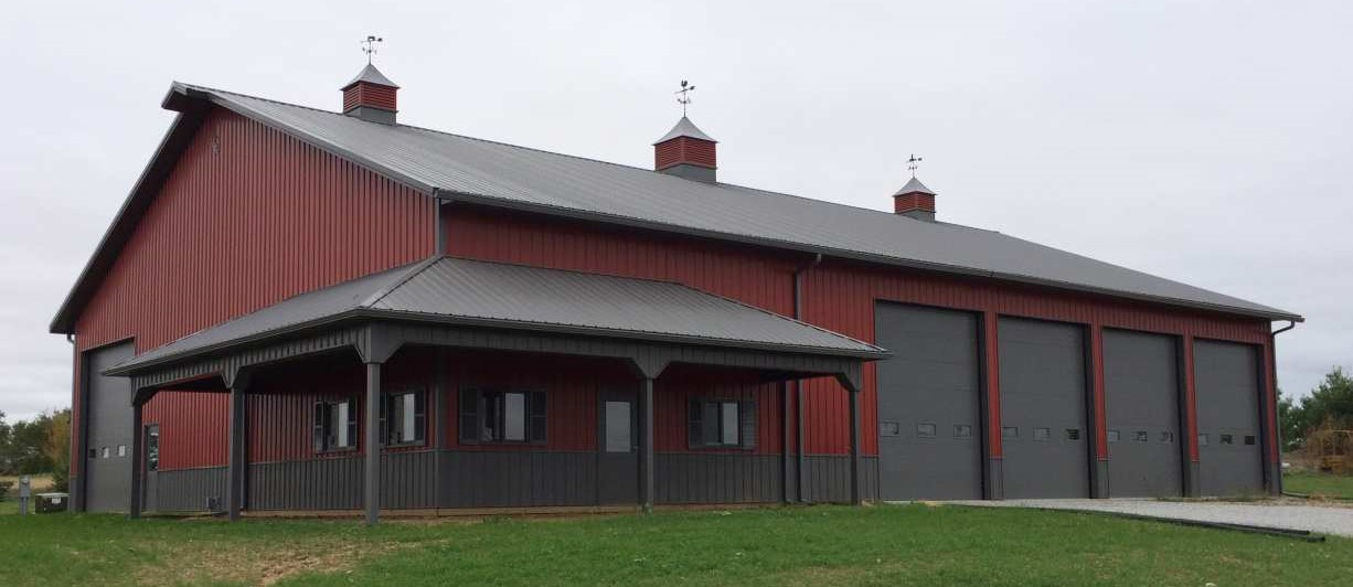 View of a farm storage building with installed door and windows